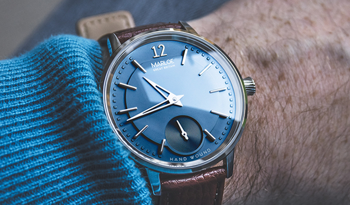 Blue dial, polished case with brown leather strap