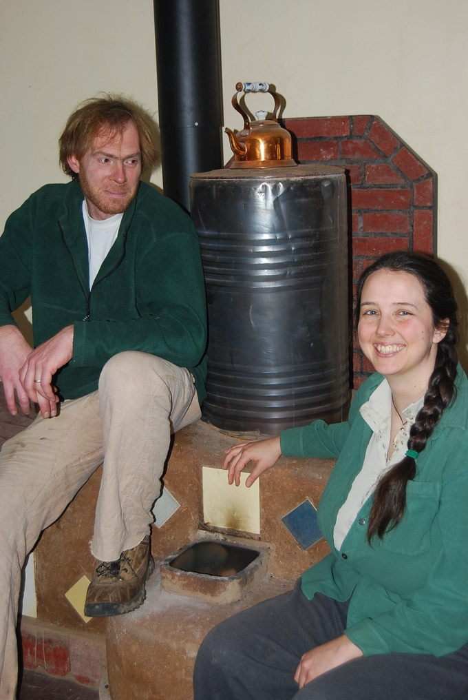 "Ernie and Erica with the Annex 6"" Rocket Mass Heater in 2009."