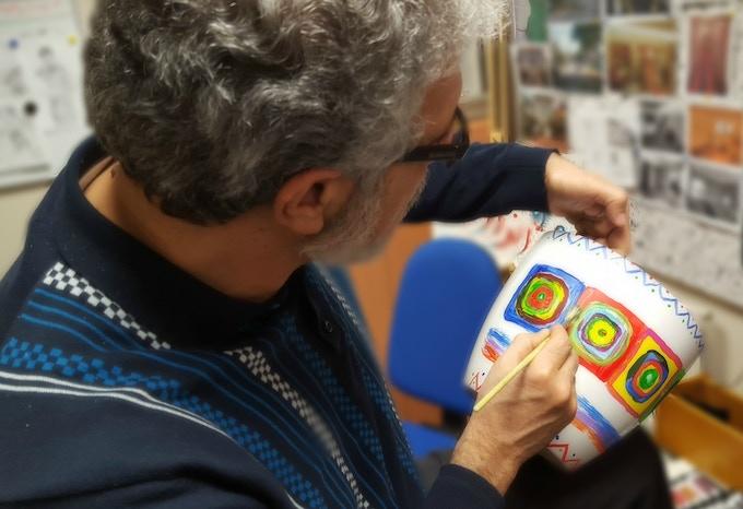 Director Hamid Khairoldin painting one of our rewards - 'Decorative Pot'