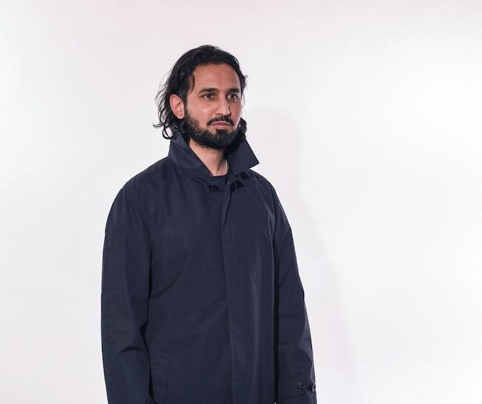 Rizwan in Navy Raincoat