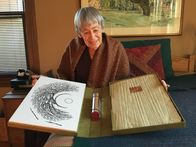 """Ursula K. Le Guin holding a rare pressing of her short story """"The Direction of the Road."""" [SOLD OUT] Photo by Katie Burkart."""