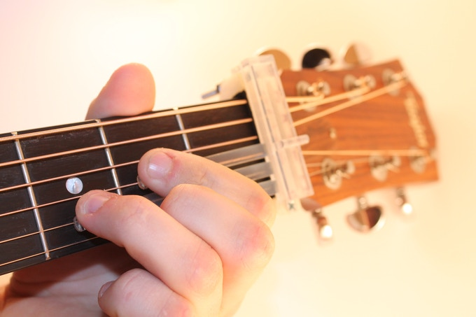 Place your fingers on the buttons and you're playing the guitar!