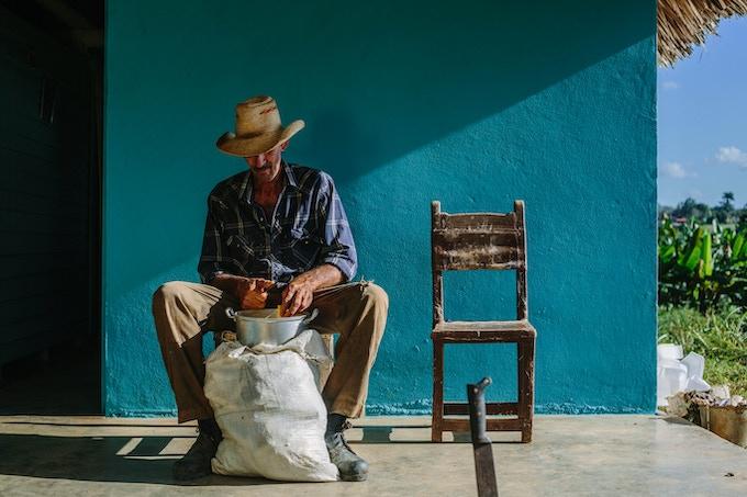 Pepe Luis, a tobacco farmer,  preps lunch for us in Viñales, Cuba. By Asori Soto.