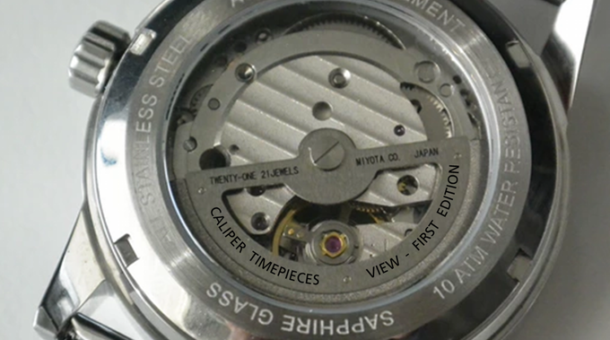 The watch name will be printed on the rotor of the automatic movement. Note that this is an illustration as the prototypes have not been printed in this way.