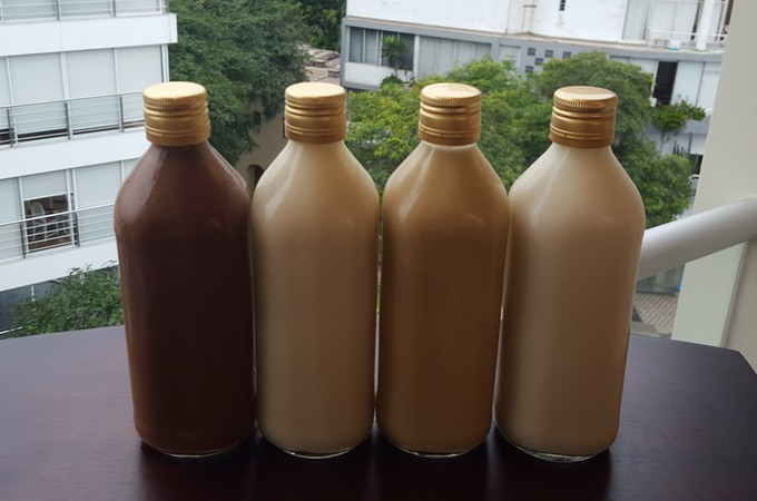 Quinoa milk samples in 4 different flavors (from left to right): Chocolate, honey, maca/carob, plain