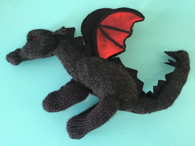 EARLY DRAGON'S SPECIAL! This one-of-a-kind rendition of Yevaud, the Dragon of Pendor, was hand-knit by poet and UKL fan Thera Webb. [SOLD OUT]