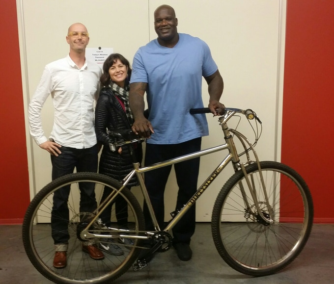 Shaquille O'Neal and his custom DirtySixer bike next to David, founder.