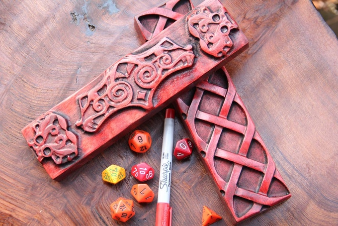 "Flame Birch with ""Demon's Blood"" finish, ""Celtic Knot"" and ""Mjolnir"" sculpts."