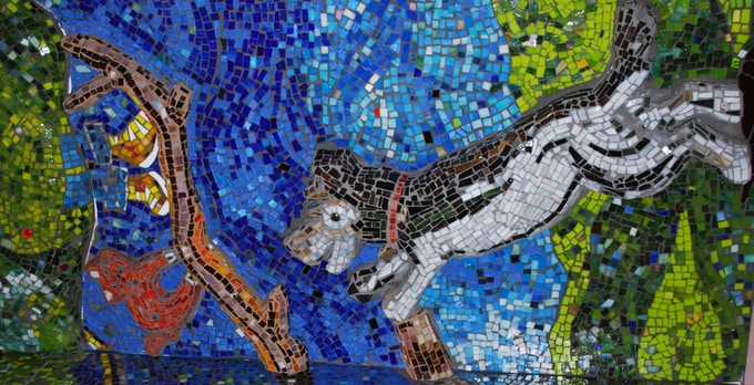 Ribsy plays in a mosaic mural at a school along the route