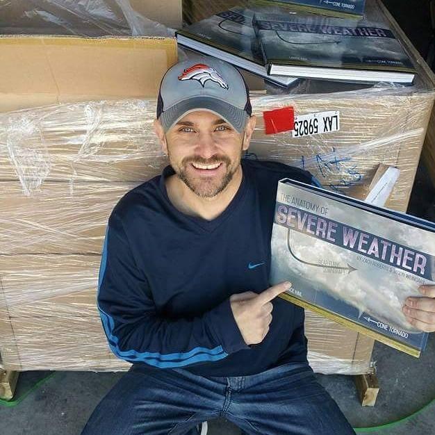 Zach cracks open the shipment.
