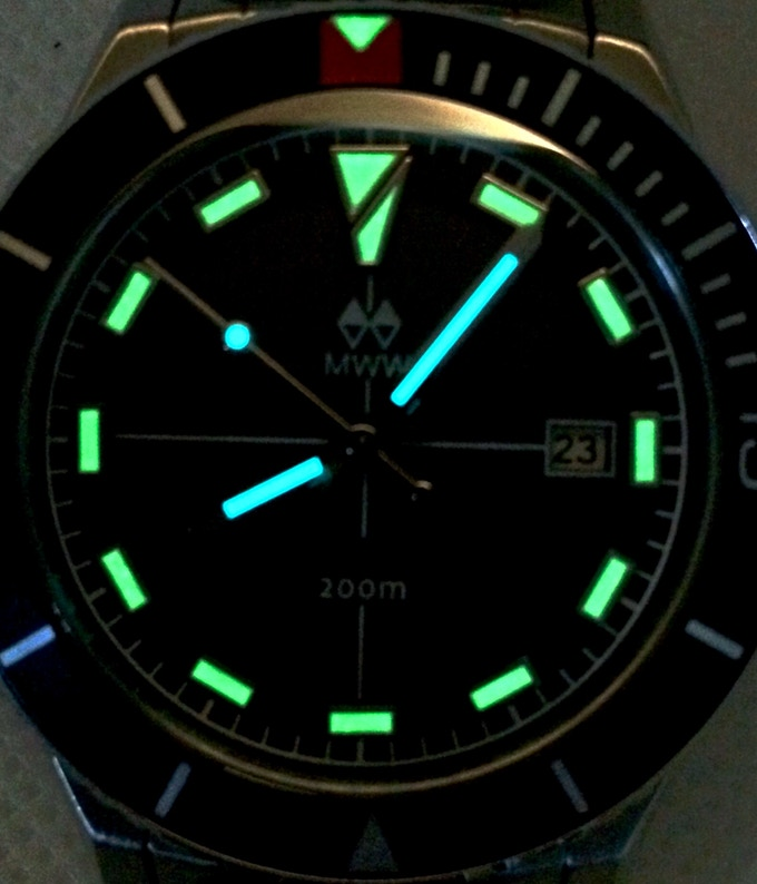 Note: All lume (hands, 12:00 bezel marker and hour markers) will glow blue on production versions.