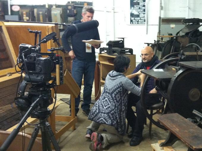 Pammi Simone mic'ing Steve Heller at Hamilton for on-camera interview (November, 2015)