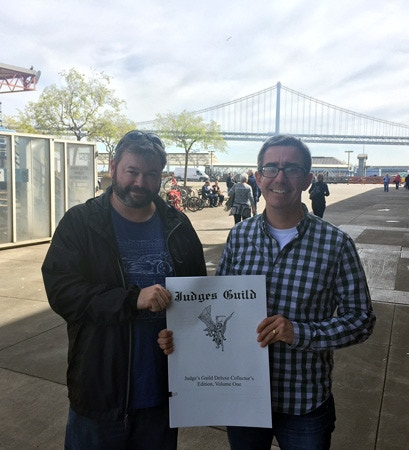 "How big is ""oversized""? THIS big. Here graphic designer Tom Denmark (left) and publisher Joseph Goodman (right) show off the latest layout draft, printed at actual size (after a lunch meeting). Yes, it's THAT big."