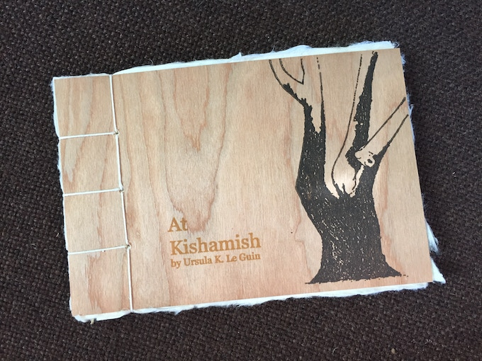 """Ursula K. Le Guin's limited chapbook """"At Kishamish,"""" available at the 1000 level. [SOLD OUT] Photo by Katie Burkart."""