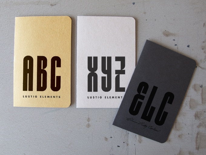 Set of 3 notebooks - 1 of each design, including black-on-black facsimile of Elaine Lustig Cohen's signature - *Note: Image above has been Photoshopped; nothing printed yet