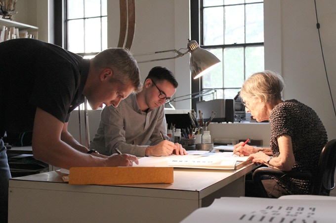 Craig Welsh, Nicholas Stover, and Elaine Lustig Cohen working on early renderings of the font