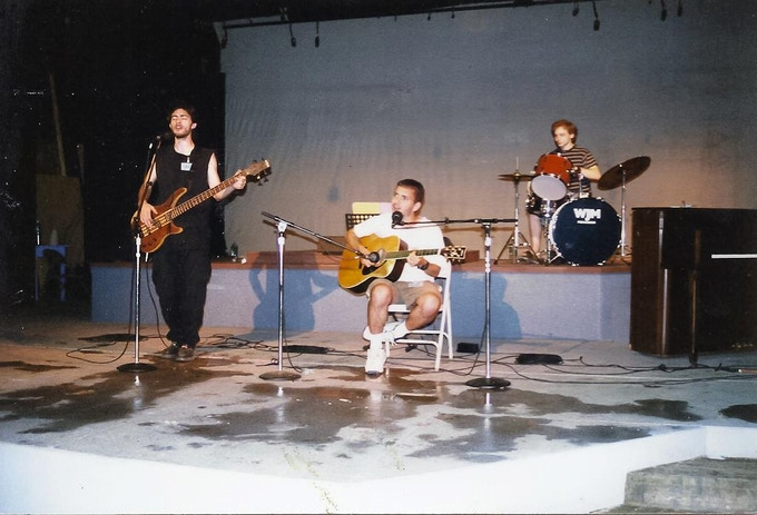me (in the middle) playing music with sam as teenagers