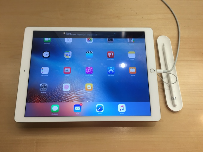 "iPad Pro on display in the Chestnut Street Apple Store in San Francisco, California. Notice the white, concave plastic tray to the right of the iPad Pro. This is what Apple calls ""home"" for the Apple Pencil."