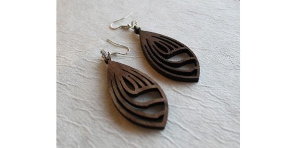 """Check out these earrings made by friend-of-the-project Eric Carlson at the """"Kelliher Fab Lab."""" Eric is working with Brian on a Lost Forty-inspired design for supporters at the $50 level."""