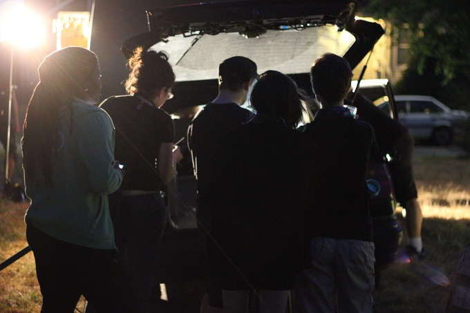 The crew filming an exterior night shot