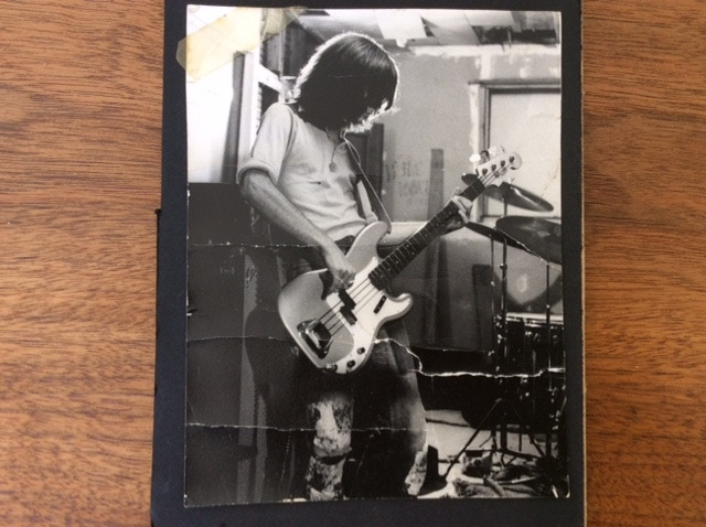 a teenage jeffrey playing his bass