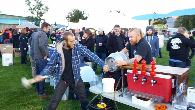 Joe & Sid tapping a cask at the Night FOG event, Oliver, BC, 2015. Photo by Ryan McWhirter.