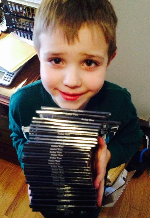 My son in 2013 with a stack of my 1st album which had just arrived. Can't wait to see him holding a stack of this new album!