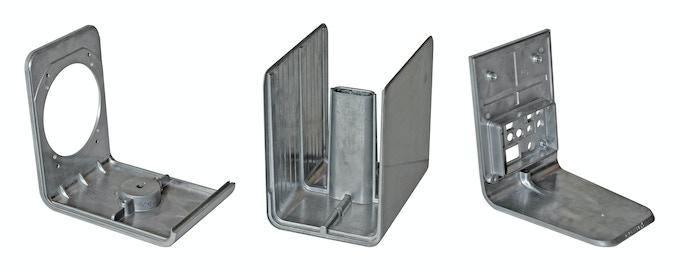 The three raw die-cast aluminum panels before powder-coating
