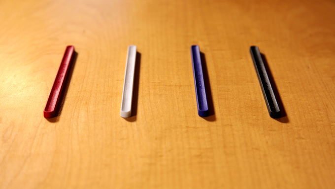 BulletTrain Magic Pencil Holder in Ruby Red, Polar White, BulletTrain Blue, and Stealth Black.
