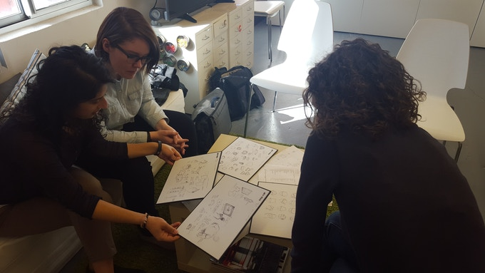 Sona and Teresa checking out prototype drawings and meeting with Catapult Design Studios to talk about the move to small-scale manufacturing.