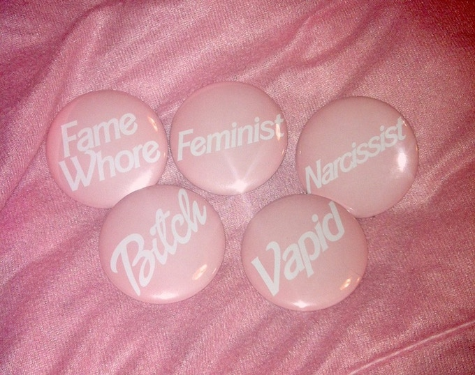 fame whore pins will be available at the school store
