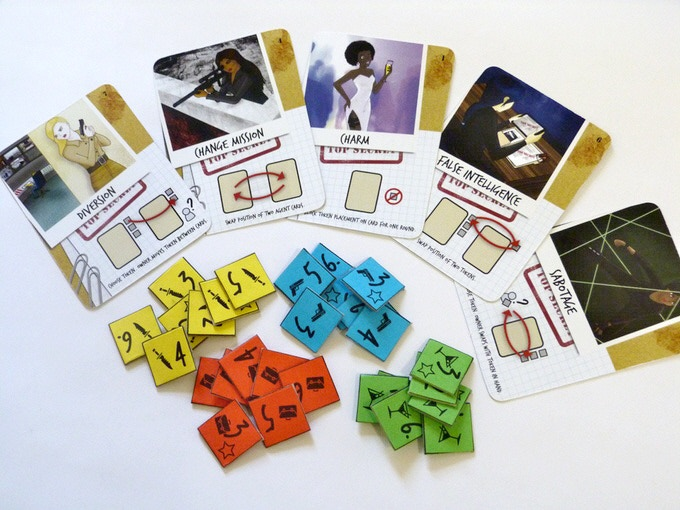 Components include 5 double-sided cards and 28 bidding tokens. (Prototype components)