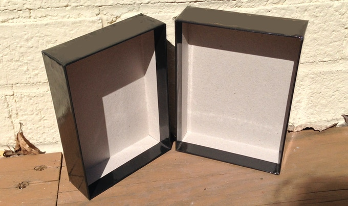 Two part hard cardboard box to hold deck and booklet