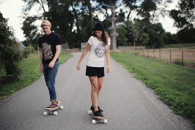The Paper Rain Project art tees, fair trade and organic. Matt & Tatiana riding on our 'Classic' barrel boards.