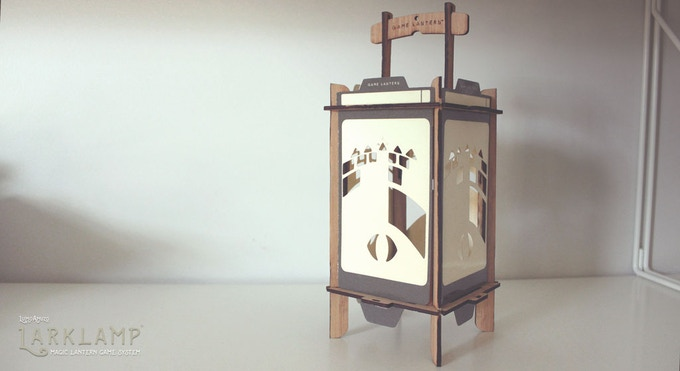 The Larklamp is crafted from bamboo (ply) and heavy coated paper panels. It stands approximately ten inches tall, and measures about four inches along each side