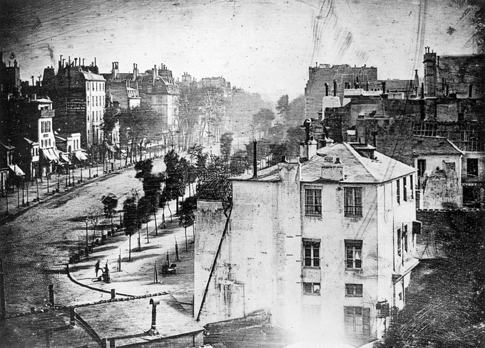 The first ever photograph of a human being, taken with a Daguerreotype camera and Chevalier lens in 1838. © Louis Jacques Mandé Daguerre, France