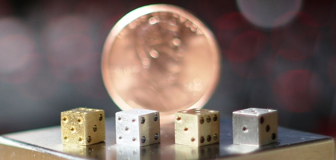 """Made from elemental metals and high-grade alloys these dice may be the smallest thing you ever roll. Just 0.1890"""" cubed."""