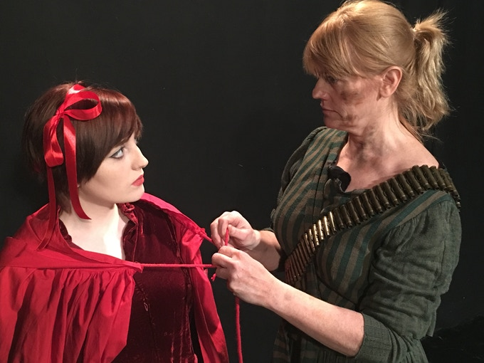 Red (Rebecca Emily Riley) takes possession of the infamous cloak from Grandmother Cheddi (Roisin Potter)