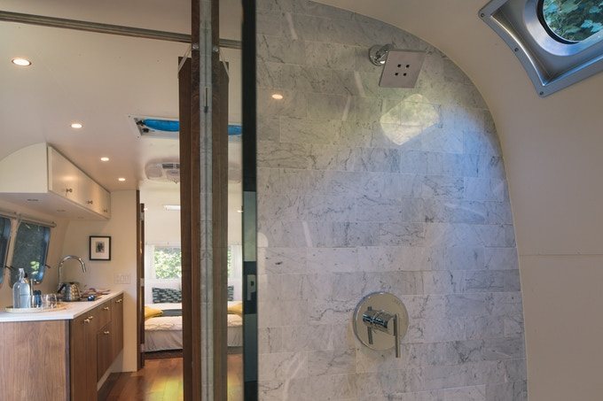 We've designed spa-inspired bathrooms into each of the Airstreams – gone are the days of camping without a hot shower!