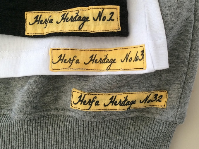 The unique cloth tags are sewn on the back, bottom right side for apparel and on the inside of the hats