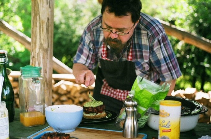 Patrick and his famous beetroot blue cheese burgers, with mushy pea topping. Photo Jacob Hoover.