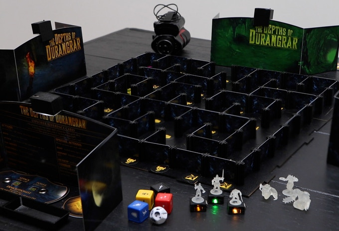 Here's a view of the game contents, including Night Vision Goggles, custom dice and miniatures, the unique 3D game board, and the screens for players and monsters.