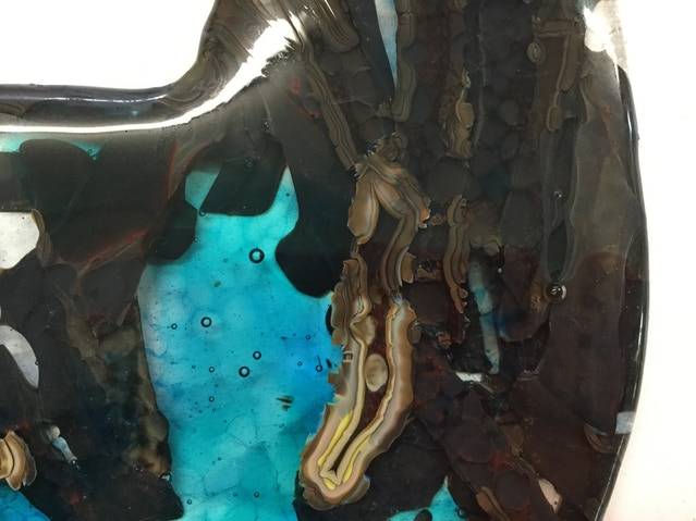 Detail of healthy ocean with oil sludge encroaching