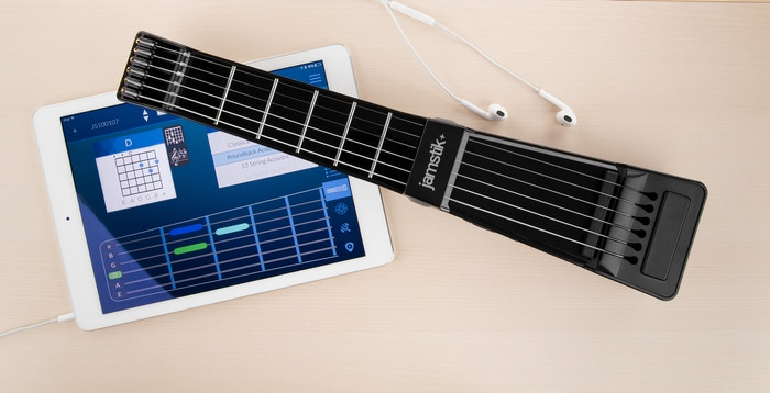 A portable guitar that teaches you to play, sounds like any musical instrument and connects wirelessly so you can play guitar anywhere.