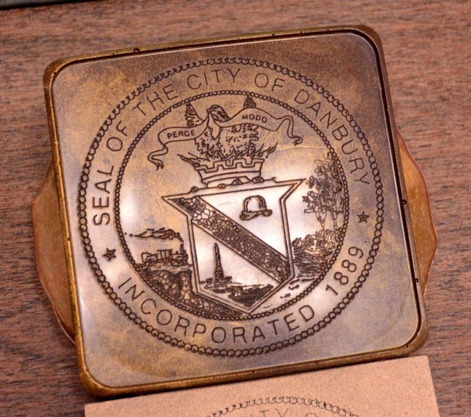 Engraved into our Golden Dark Chocolate, this city seal of Danbury, CT is some of our best work yet!