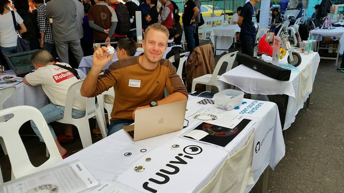 Lauri showing RuuviTags at the Maker Party event in Chiang Mai, Thailand