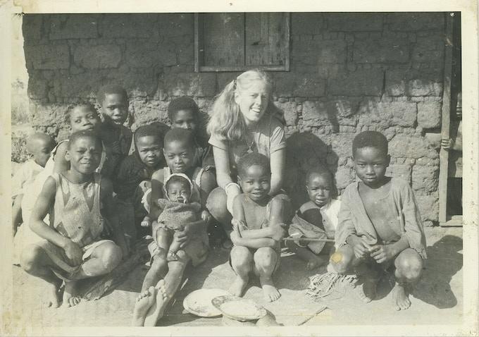 Beth with neighborhood kids, Kamponde, 1981