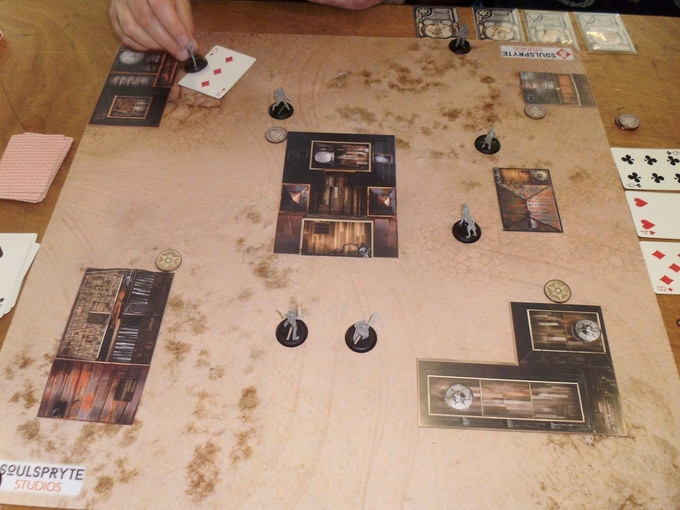A game of Bloodstone Frontier in progress. The flat buildings are an early stretch goal, but are replicated in the back of the rulebook