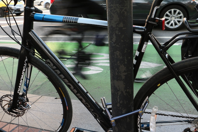 Easily locks around the rear tire and frame.