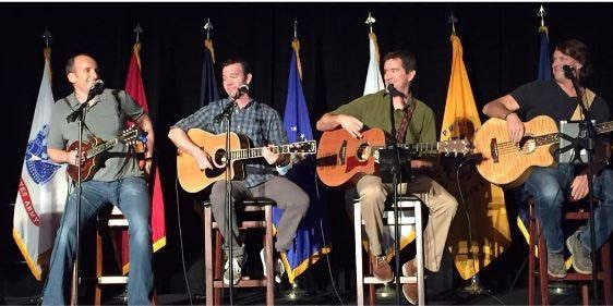 Rob Raymond, Keith Broecker, Tom Abbott, and Steve Speckhard performing for MOAA